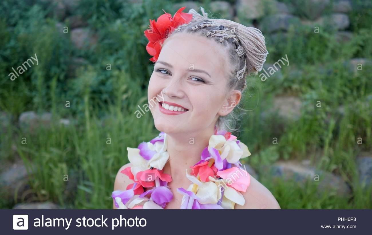 Flower garland hawaii stock photos flower garland hawaii stock hawaii woman with flower lei garland of pink orchids beautiful smiling caucasian woman in bikini izmirmasajfo