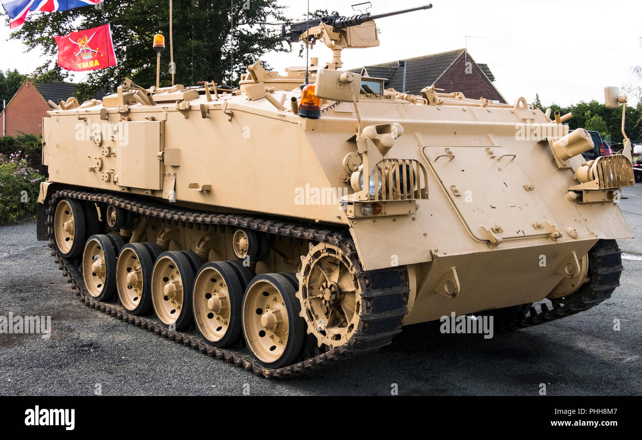 Ex army FV 432 in desert colours on display - Stock Image