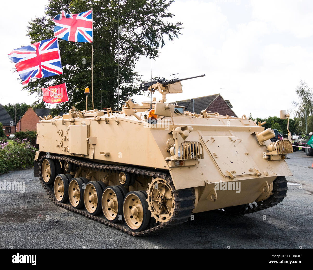 Ex army AFV 432 in desert colours on display - Stock Image