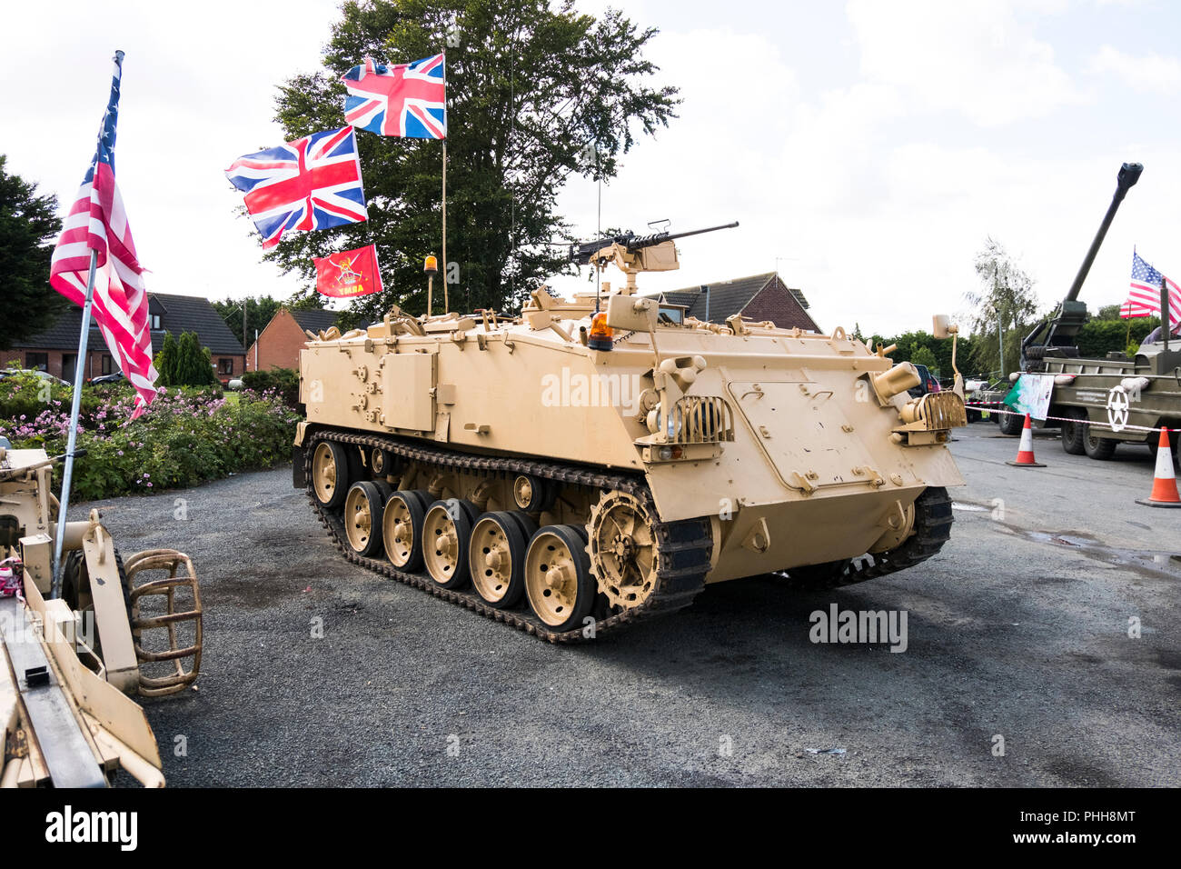 Ex British army AFV432 in desert colours on display - Stock Image