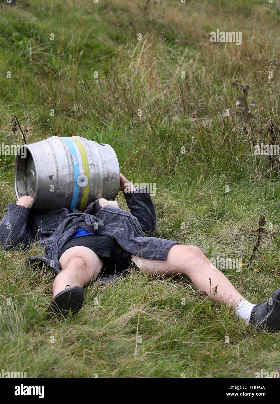 Littleborough, Manchester, UK. 1st September, 2018. The first ever World Beer Keg Carrying championships organised by Brian Gumbley and the 'Always with a smile' foundation.  The competition involves a three quarter mile sprint to pick up a beer keg weighing 50kg and proceeding to carry it up Blackstone edge to a finish point near the White House.  Littleborough, 1st September, 2018 (C)Barbara Cook/Alamy Live News - Stock Image