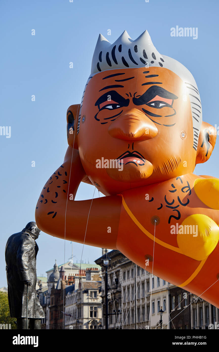 London, U.K. - 1 September 2018: A balloon of London mayor Sadiq Khan (appearing  to lean on the statue of Churchill) flown in Parliament Square at the Make London Safe protest. Credit: Kevin Frost/Alamy Live News - Stock Image