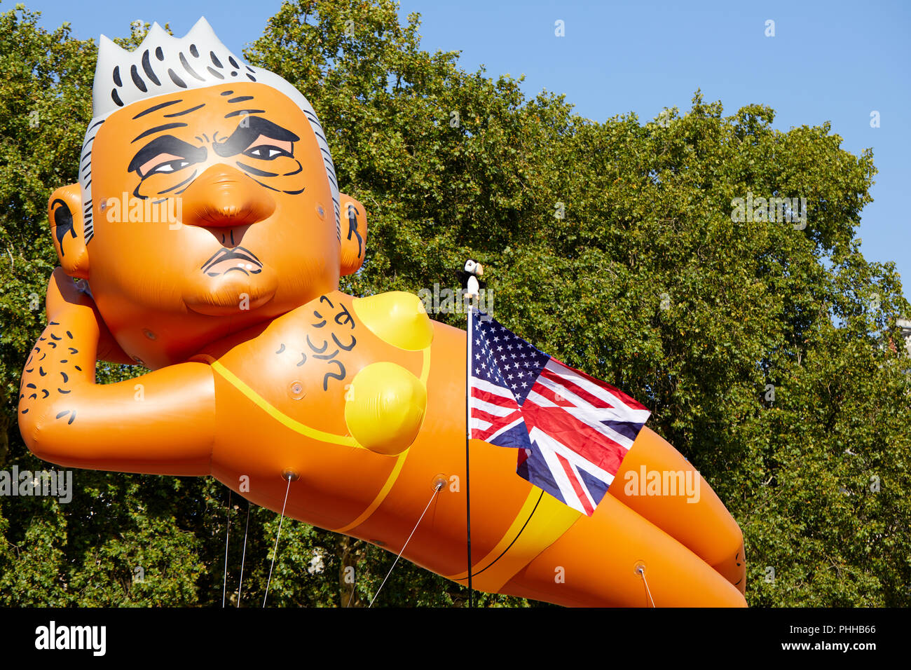 London, U.K. - 1 September 2018: A balloon of London mayor Sadiq Khan, in front of a combined US/UK flag, is flown in Parliament Square at the Make London Safe protest. Credit: Kevin Frost/Alamy Live News - Stock Image