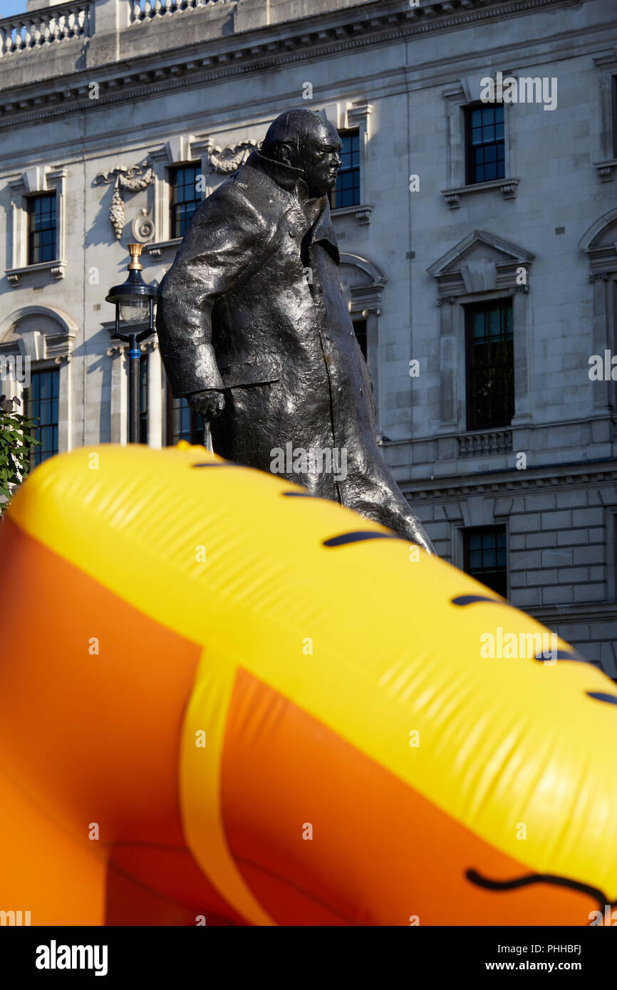 London, U.K. - 1 September 2018: The feet of a balloon mocking London mayor Sadiq Khan as it is inflated in front of the statue of Winston Churchill before being flown in Parliament Square at the Make London Safe protest. Credit: Kevin Frost/Alamy Live News - Stock Image