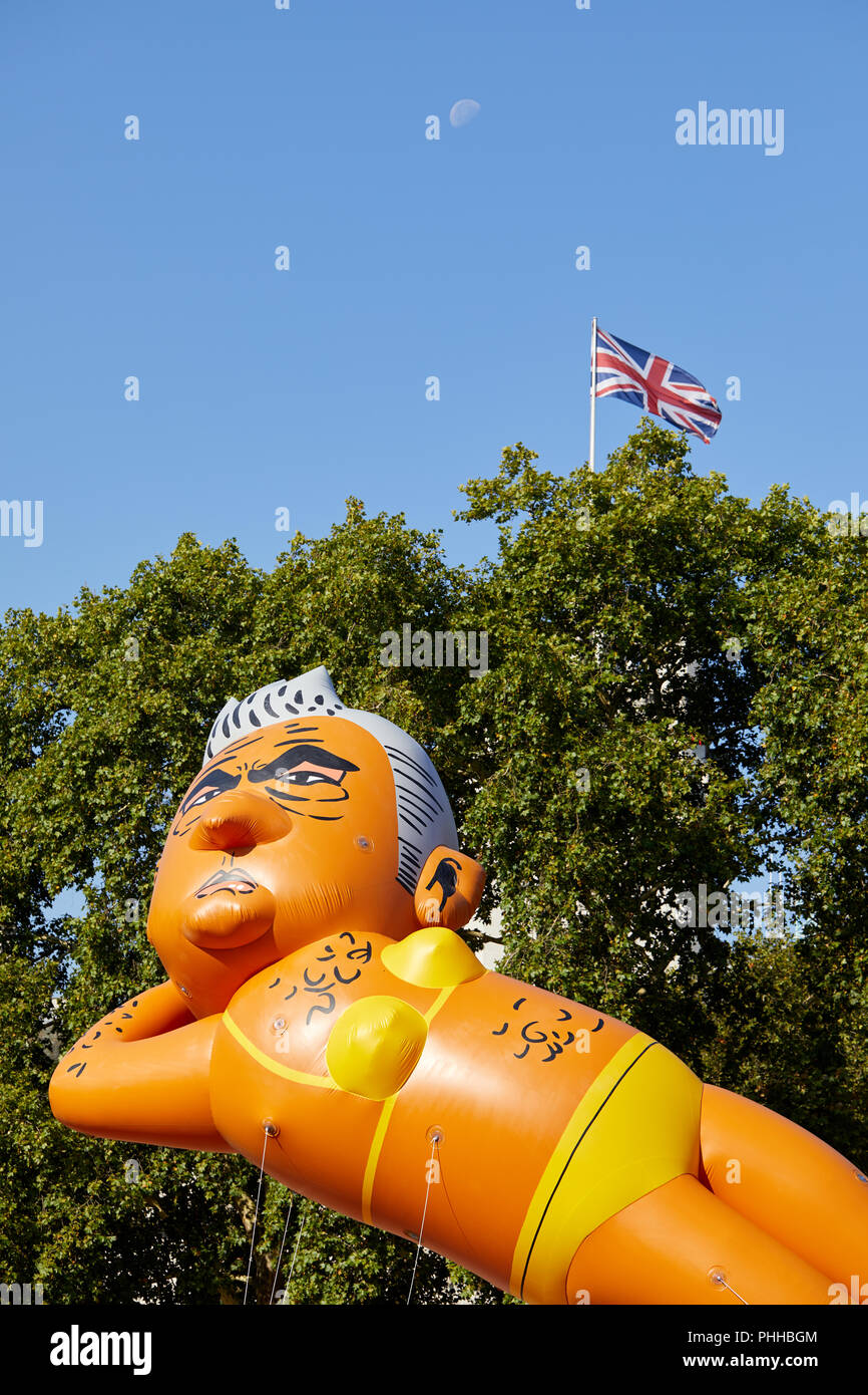 London, U.K. - 1 September 2018: A balloon of London mayor Sadiq Khan is flown in Parliament Square in front of a Union Jack and the moon at the Make London Safe protest. Credit: Kevin Frost/Alamy Live News - Stock Image