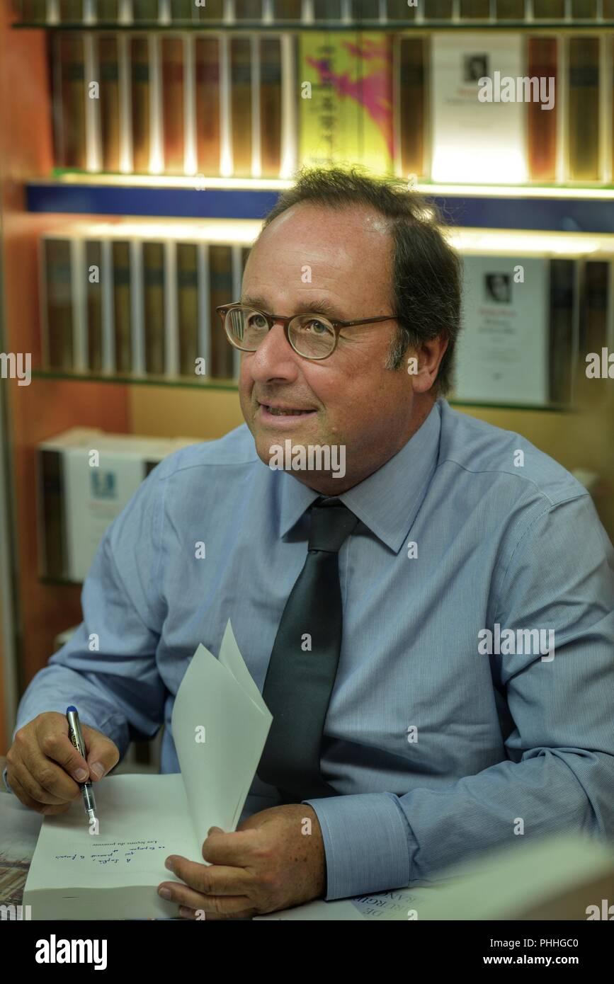Normandy, France  1st Sept, 2018  François Hollande dedication book