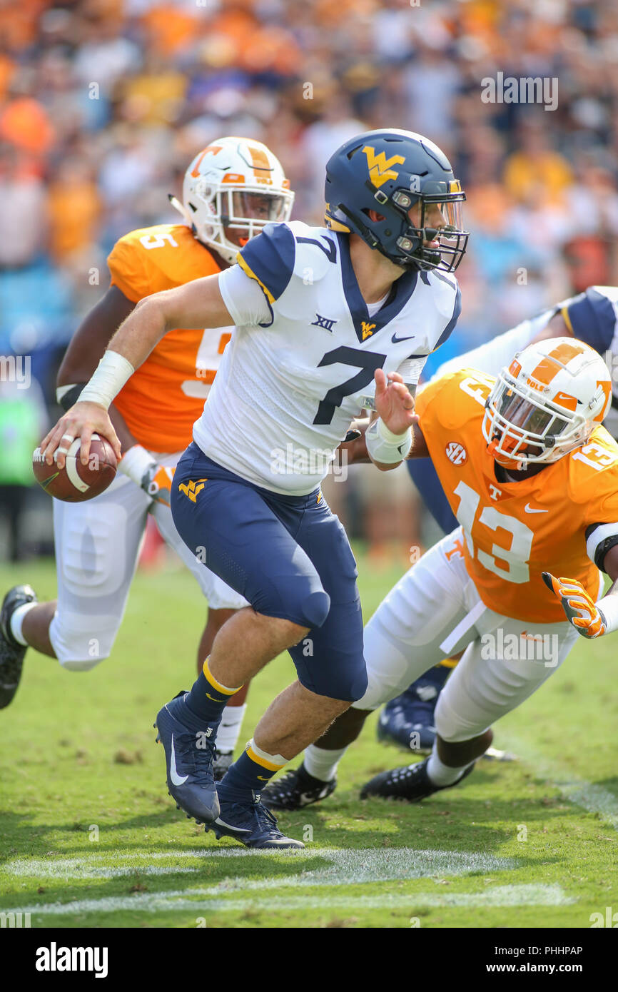 Charlotte, NC, USA. 1st Sep, 2018. West Virginia Mountaineers quarterback Will Grier (7) breaks out of the pocket during NCAA football game between the West Virginia Mountaineers and the Tennessee Volunteers at the Belk College Kickoff at Bank of America Stadium in Charlotte, NC. Jonathan Huff/CSM/Alamy Live News - Stock Image