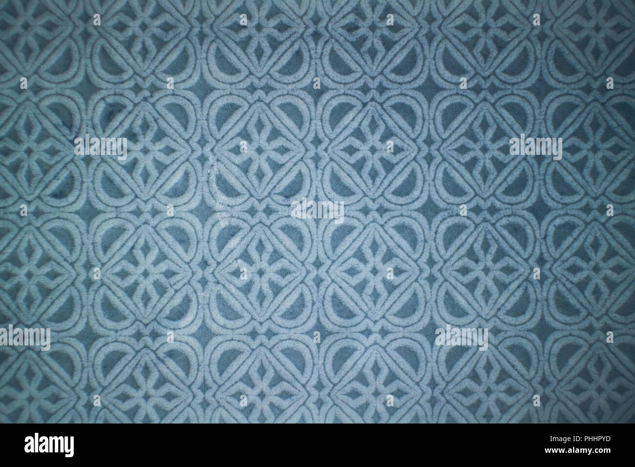 Ceramic blue tile with decorative pattern. - Stock Image