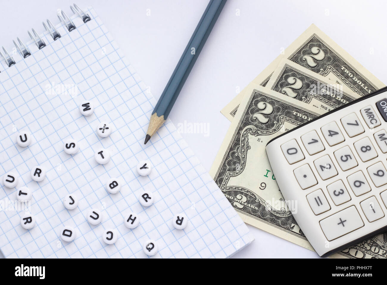 close-up, on a white background calculator, money and a notepad with
