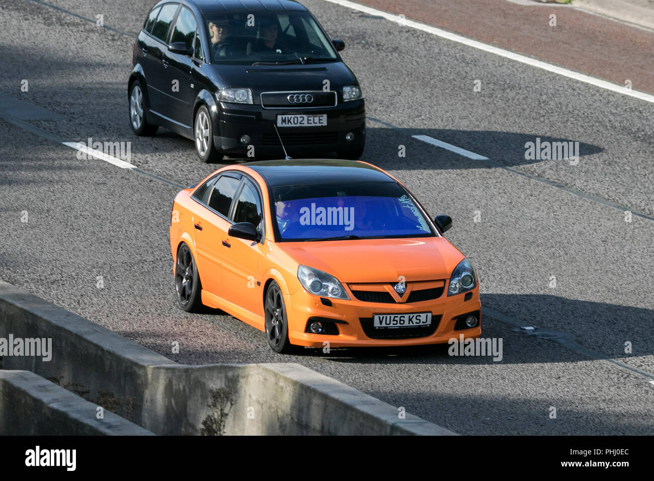 0range Vauxhall Vectra SRI Xpnav CDTI 150  specialist, collectable future classic cars on the M6 at Lancaster, UK - Stock Image