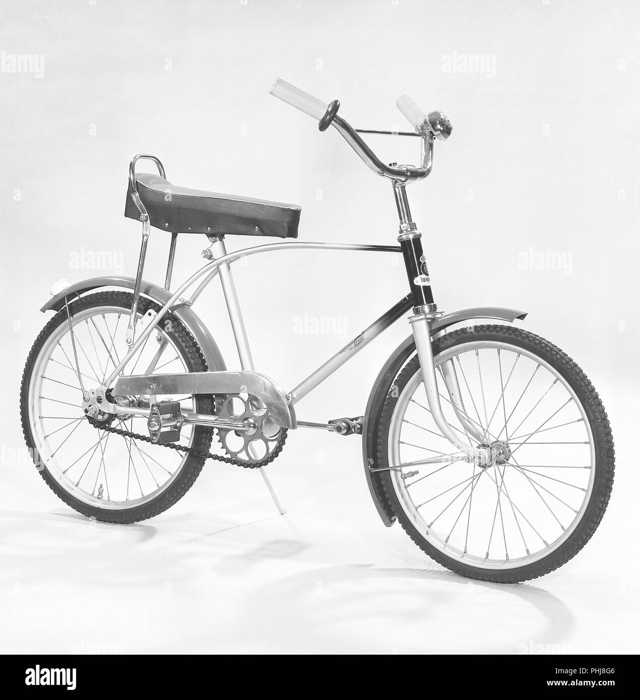 1950s bicycle. A childrens bicycle model Cross from manufacturer Husqvarna. A bicycle model that was considered the coolest thing around for a child of the 1950s with high handlebars and a loaf seat. Sweden 1950s  Ref BV40-12 - Stock Image