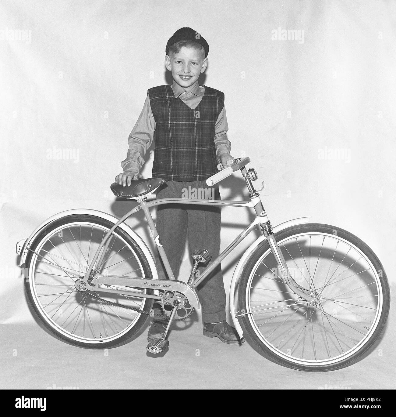 1950s bicycle. A boy with a brand new childrens bicycle from the manufacturer Husqvarna. Sweden 1940s. Ref BV40-12 Stock Photo