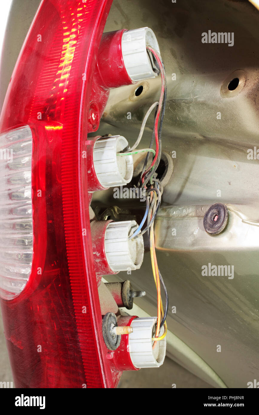 rear lights with lamp bases dismantled from car body to review and service - Stock Image