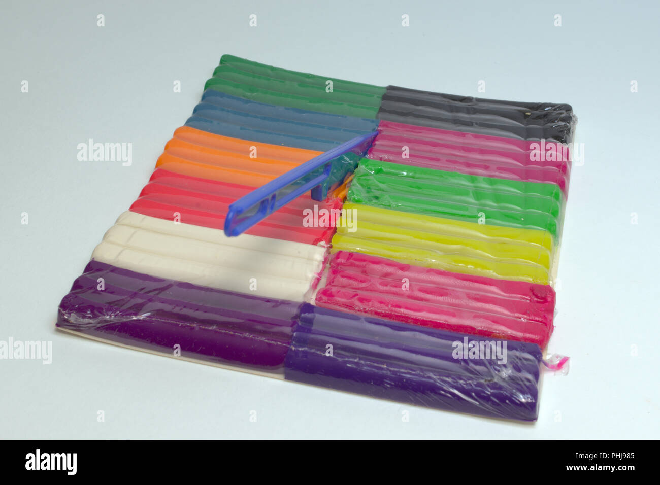 wax plasticine. multicolored set with modeling tool, with clipping path - Stock Image