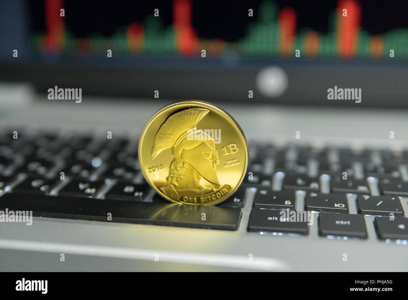Golden Titan Bitcoin Coin On A Silver Keyboard Of Laptop And Diagram Chart Graph Screen As Background Virtual Cryptocurrency Concept