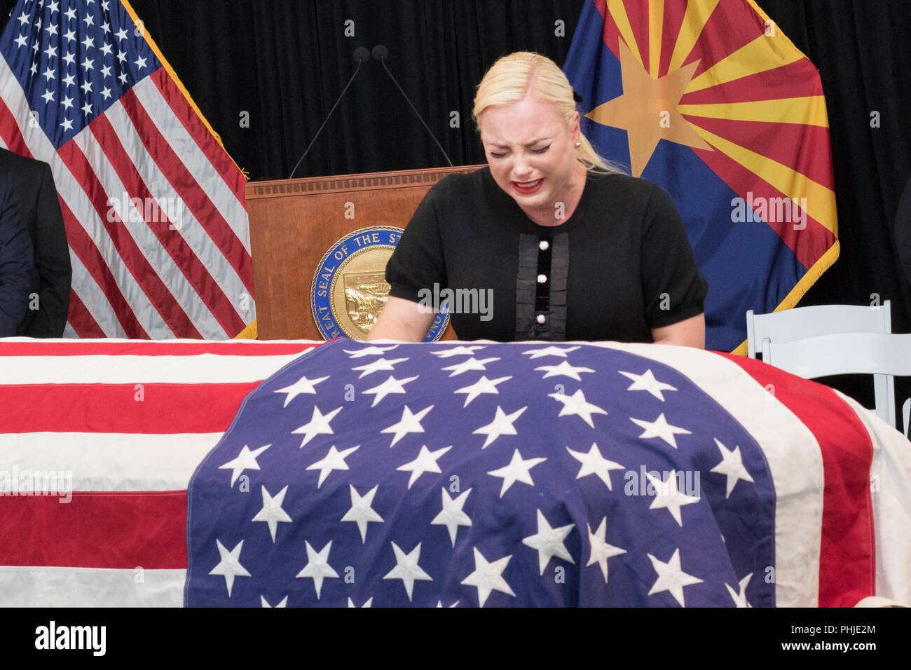 Meghan McCain, daughter of Sen. John McCain, weeps next to his flag draped casket laying in state at the Arizona State Capitol August 29, 2018 in Phoenix, Arizona. The former senator's remains will lie in state in the U.S. Capitol Rotunda before burial at the U.S. Naval Academy. - Stock Image
