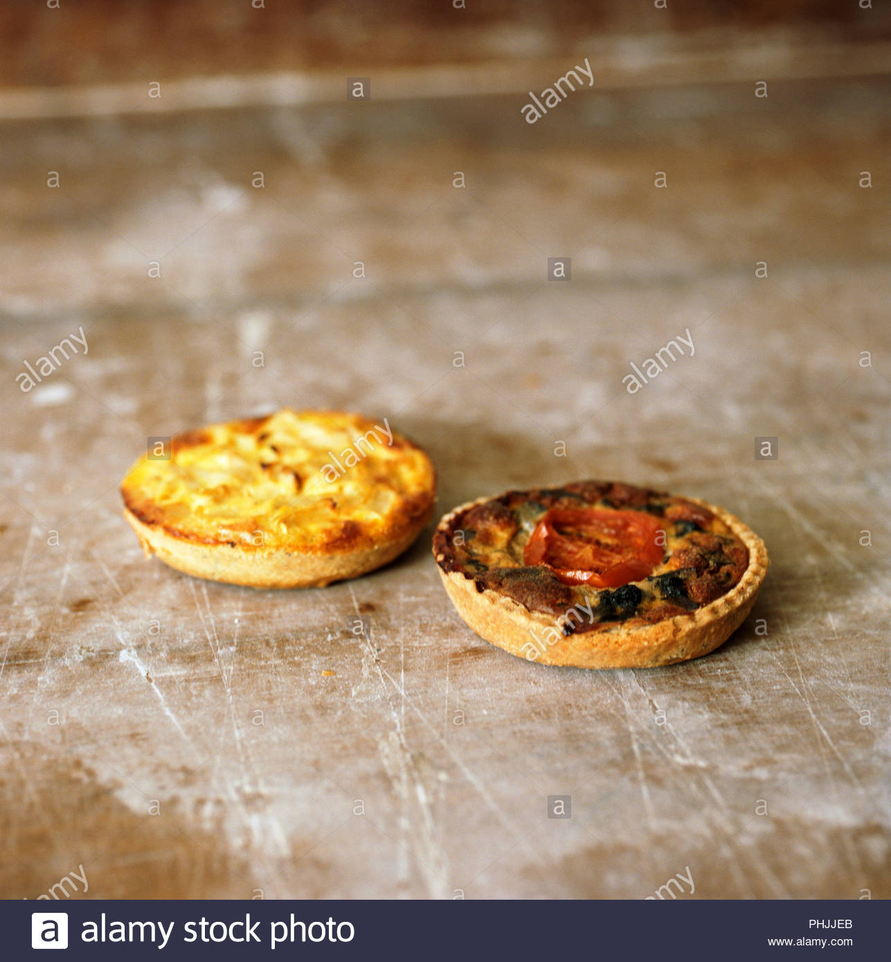 Pastries on wooden table - Stock Image