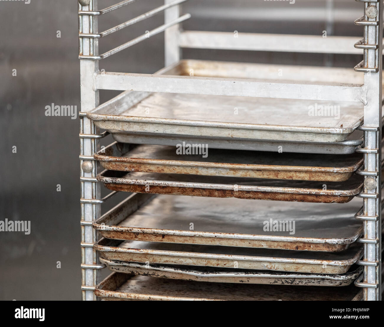 rack holding sheet pans in a commercial kitchen - Stock Image