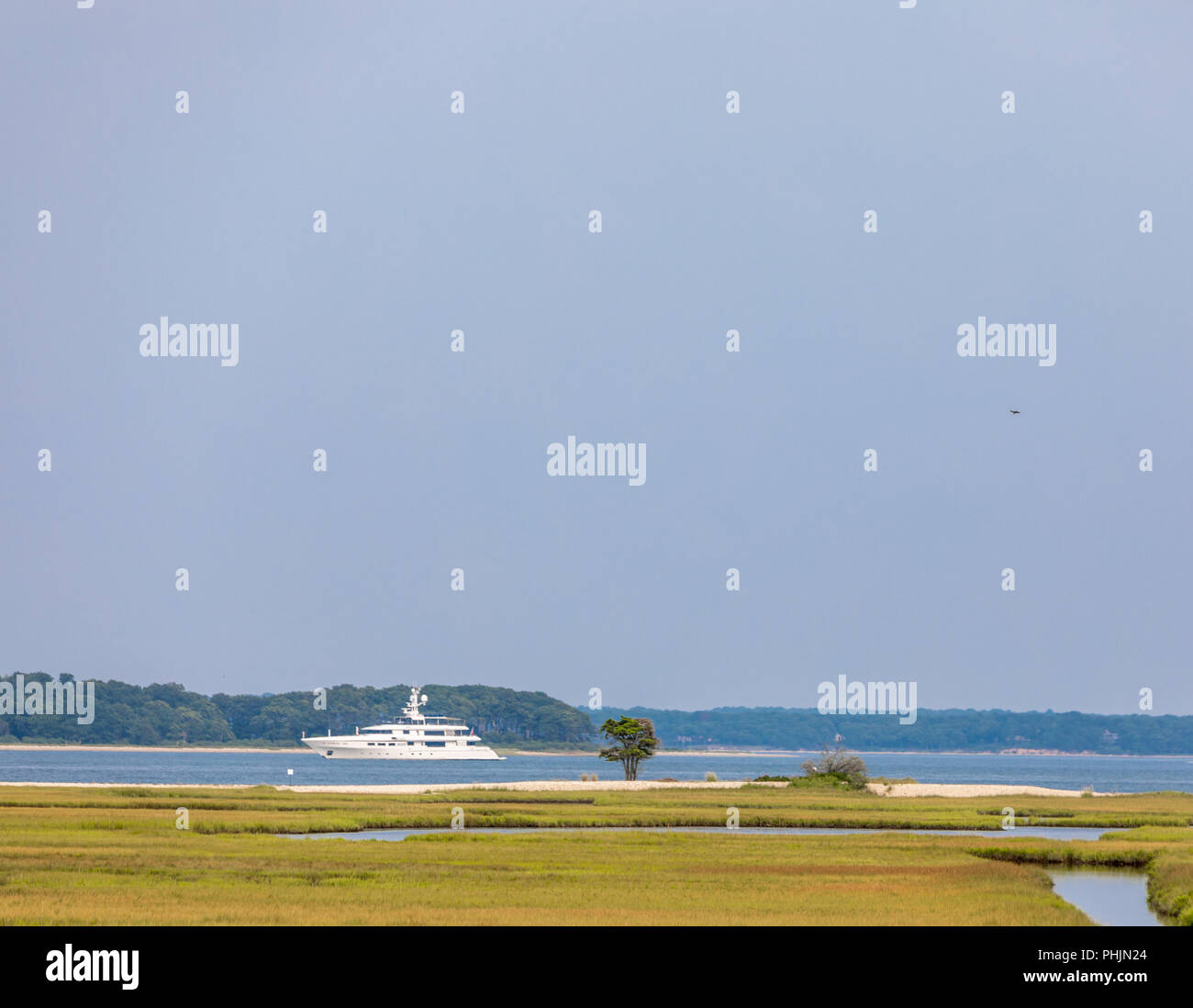 a large yacht off the shore of a nature preserve in North Haven NY Stock Photo