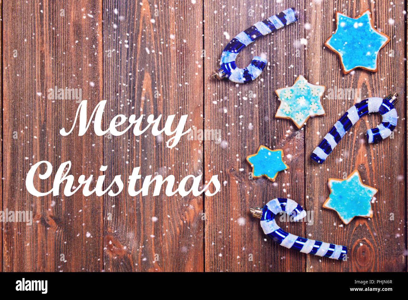 Merry Christmas Christmas Gingerbread Cookies Of A Blue Star With Christmas Tree Decorations On A Brown Wooden Table Copy Space Stock Photo Alamy