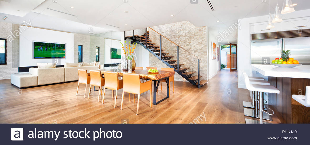 Open plan living area with hardwood floor - Stock Image