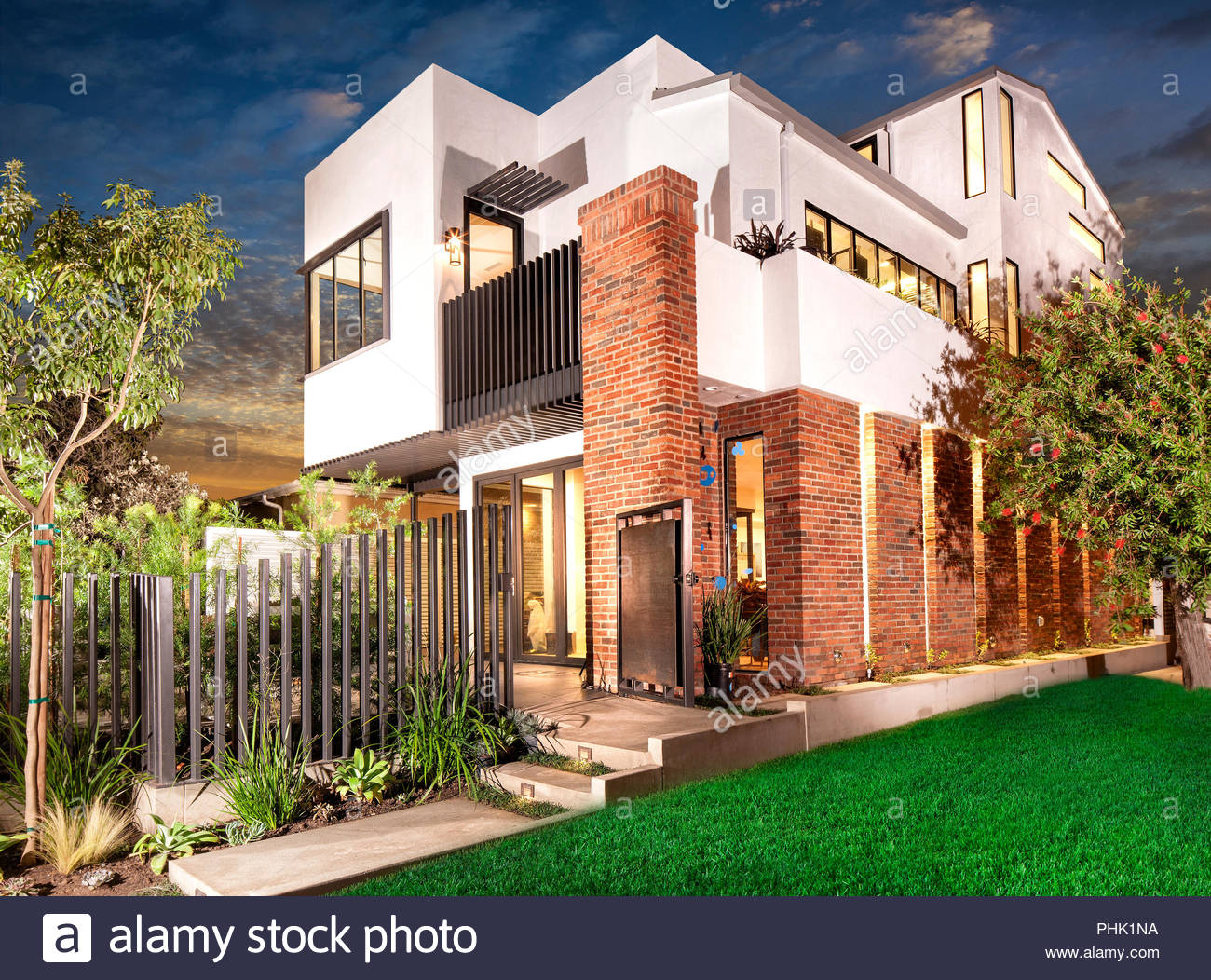 House and garden exterior at sunset - Stock Image