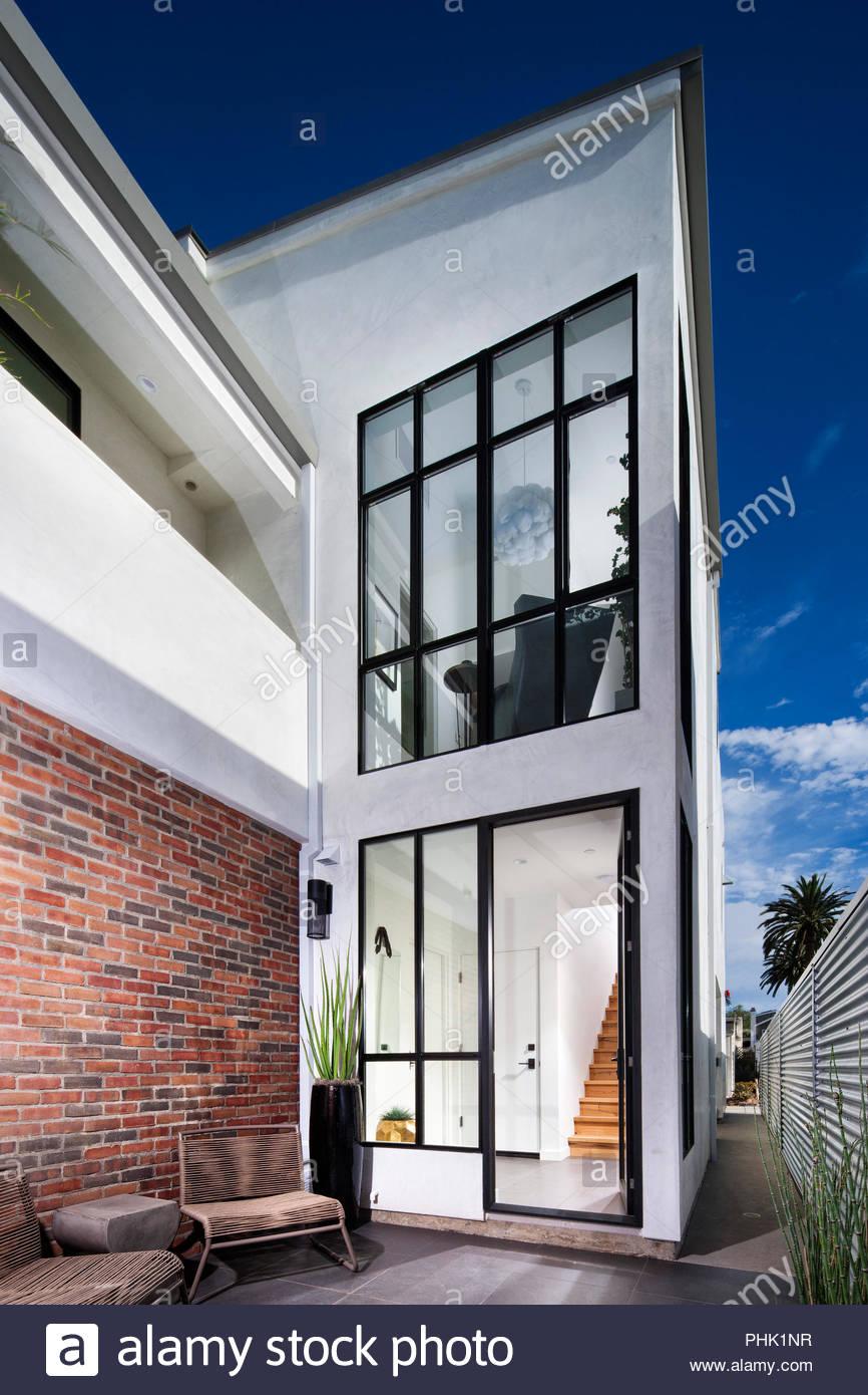 House exterior with open front door Stock Photo