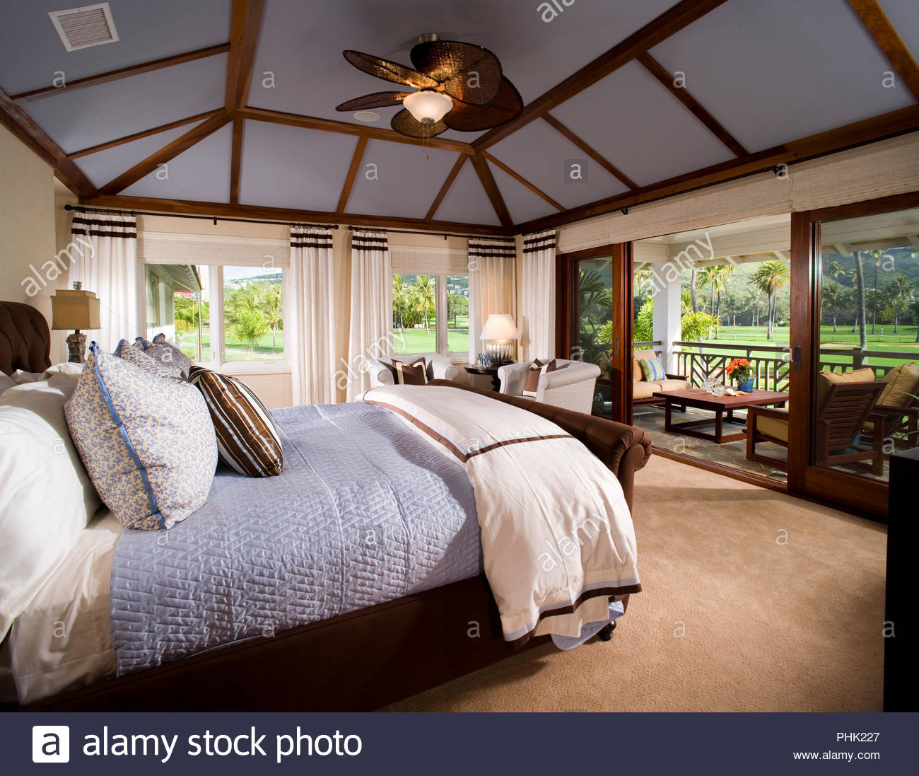 Bedroom with ceiling fan - Stock Image