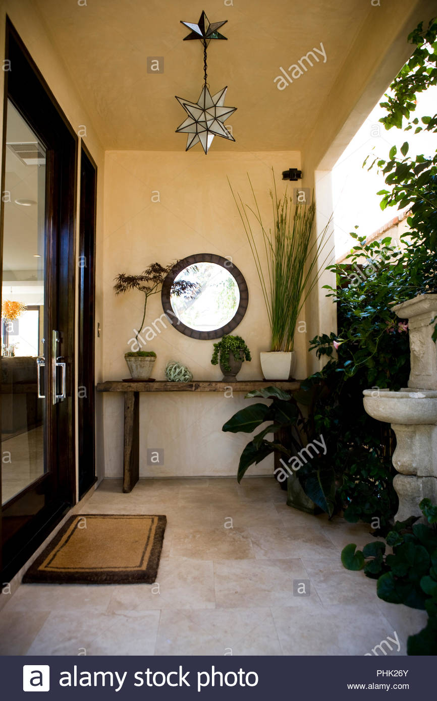Pot plants and fountain on patio - Stock Image