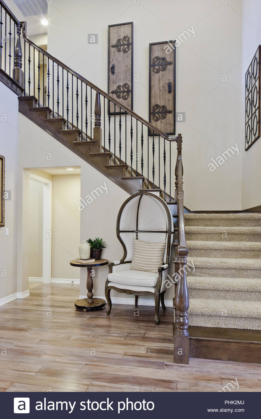 Chair by staircase - Stock Image