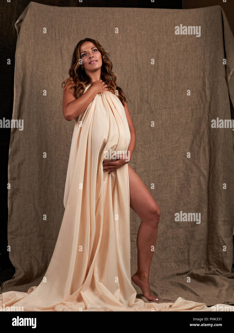 Young beautiful smiling pregnant woman. Happy Maternity concept - Stock Image