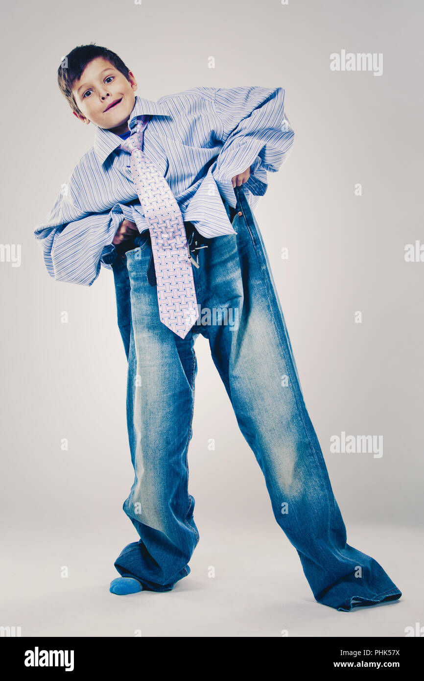 funny boy wearing Dad's clothes - Stock Image