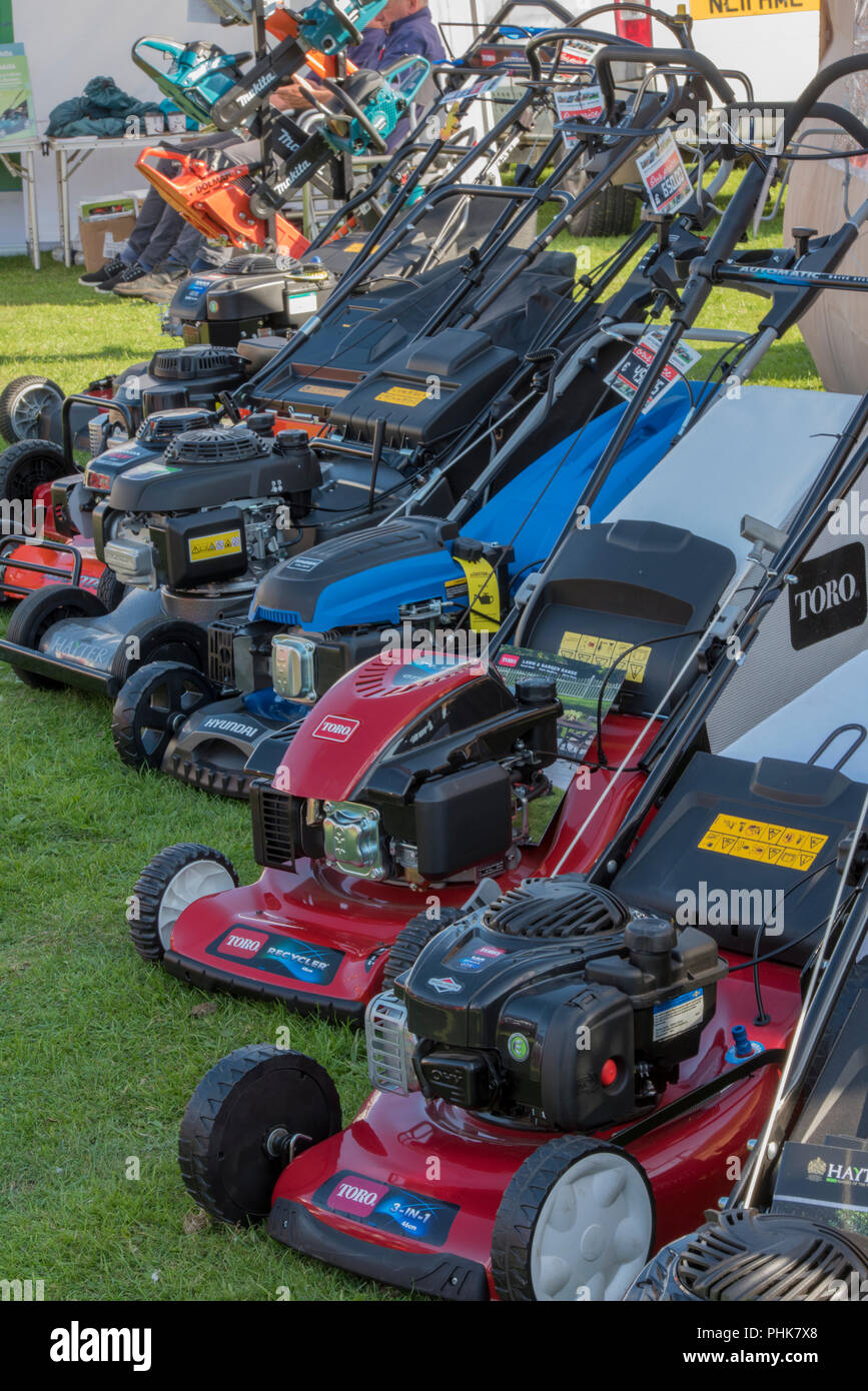 petrol lawnmowers on sale at a garden centre. - Stock Image