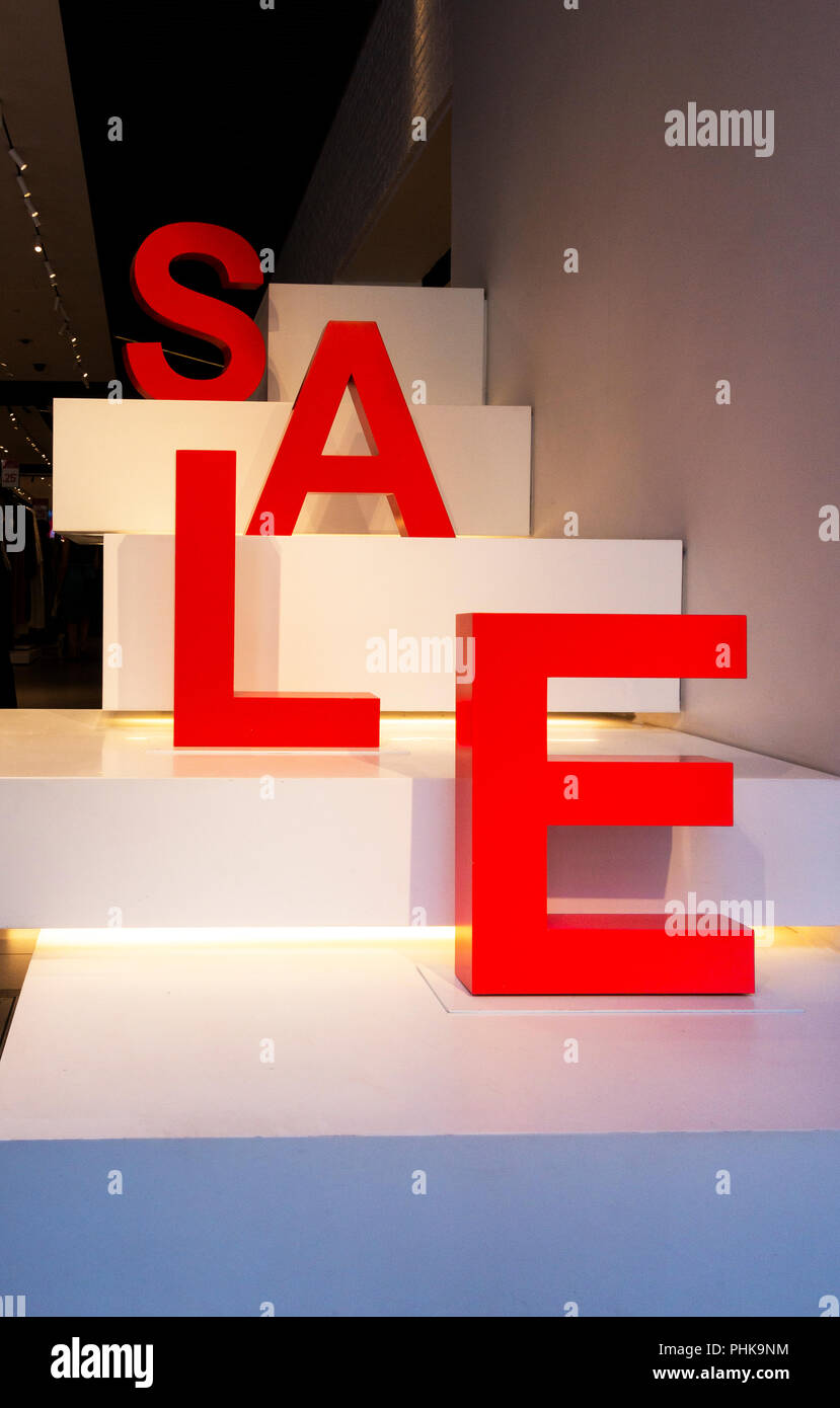 Three-dimensional red letters spell out SALE in the window of a shop in New York City - Stock Image