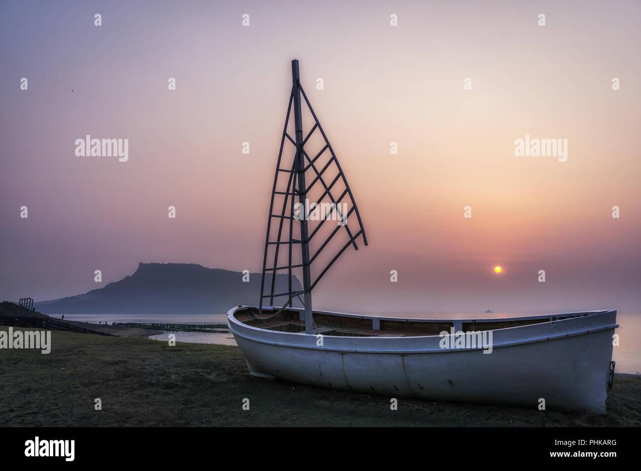 sunrise view sailboat gwangchigi beach - Stock Image