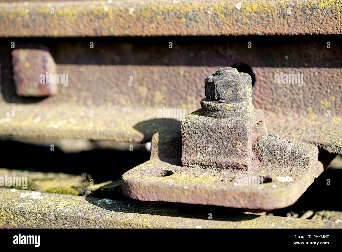 Screw connection on a railroad track in the port of Magdeburg - Stock Image