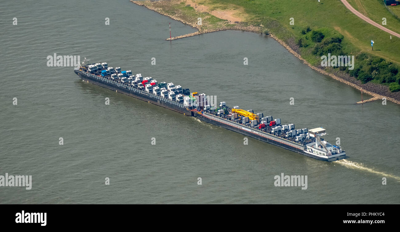 Aerial view, cargo ship on the Rhine goes uphill, push boat with additional lighters, tractors and trucks are the freight, inland navigation Duisburg, - Stock Image