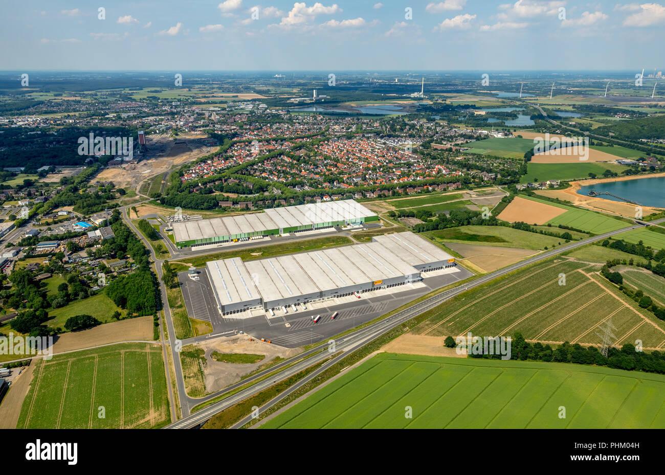 Aerial view, logistics location Logport 6 in Kamp-Lintfort, former coal storage site, belongs to Duisport - Duisburger Hafen, warehouses for truck han - Stock Image