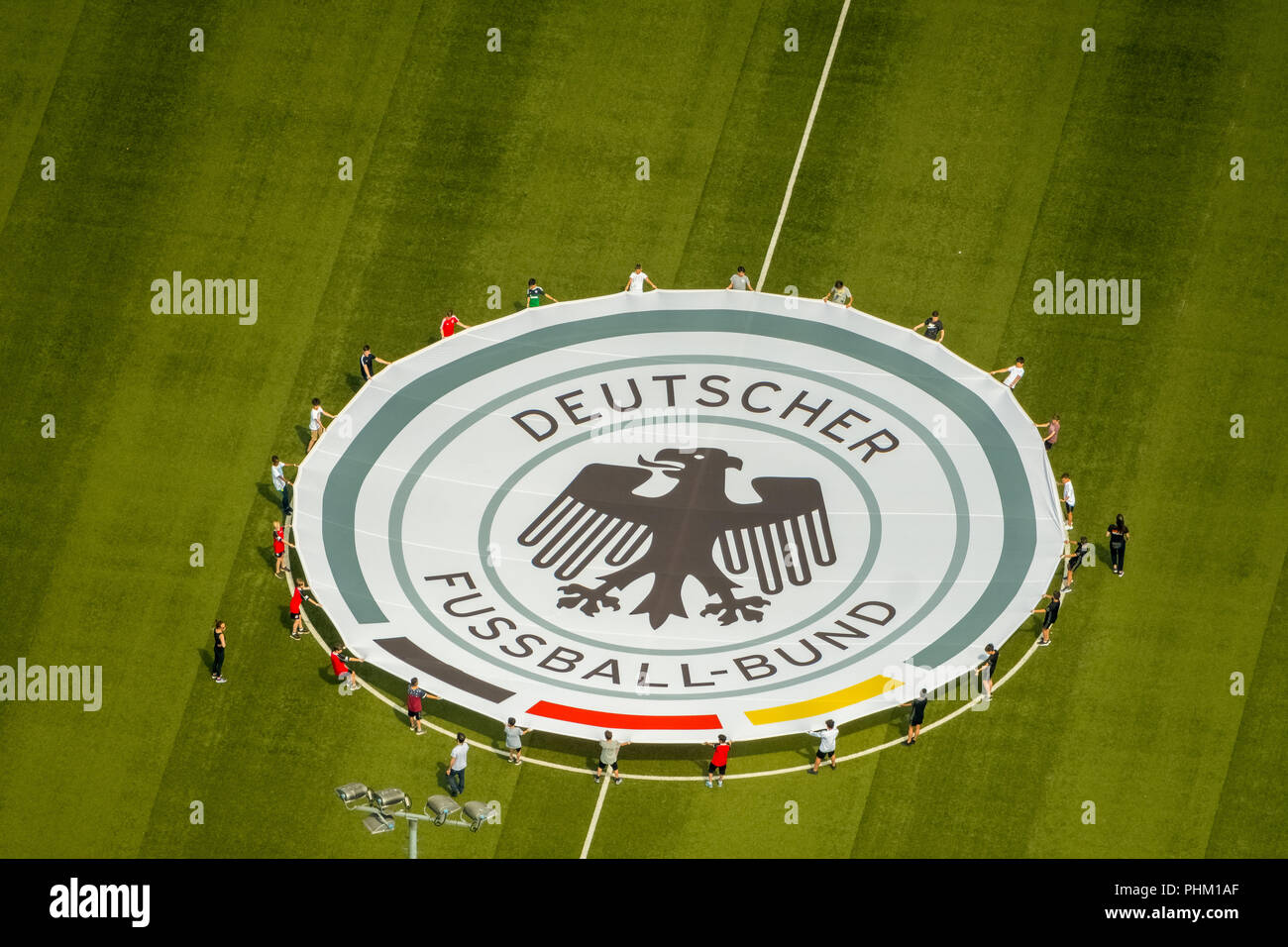 Aerial view, youth players practice rolling out the emblem of the German Football Association, Stadium Niederrhein, Stadion SC Rot-Weiß Oberhausen e.V Stock Photo