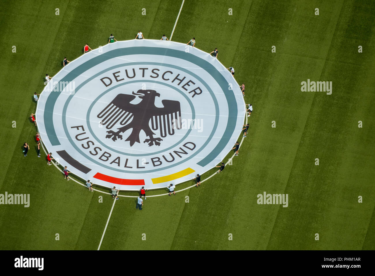 Aerial view, youth players practice rolling out the emblem of the German Football Association, Stadium Niederrhein, Stadion SC Rot-Weiß Oberhausen e.V - Stock Image