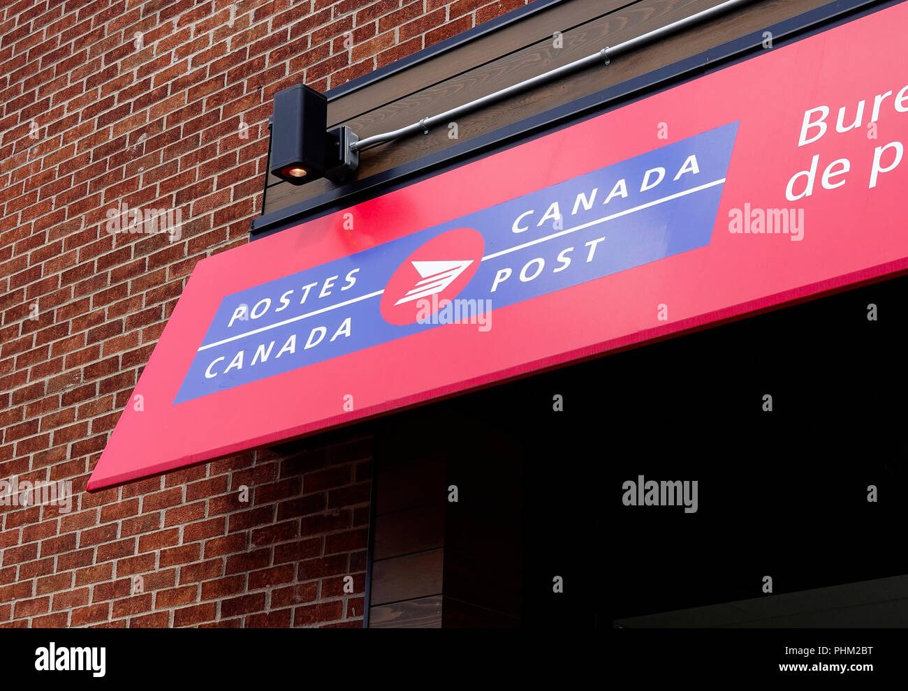 The awning outside of a Canada Post Office in Montreal, QC, Canada - Stock Image