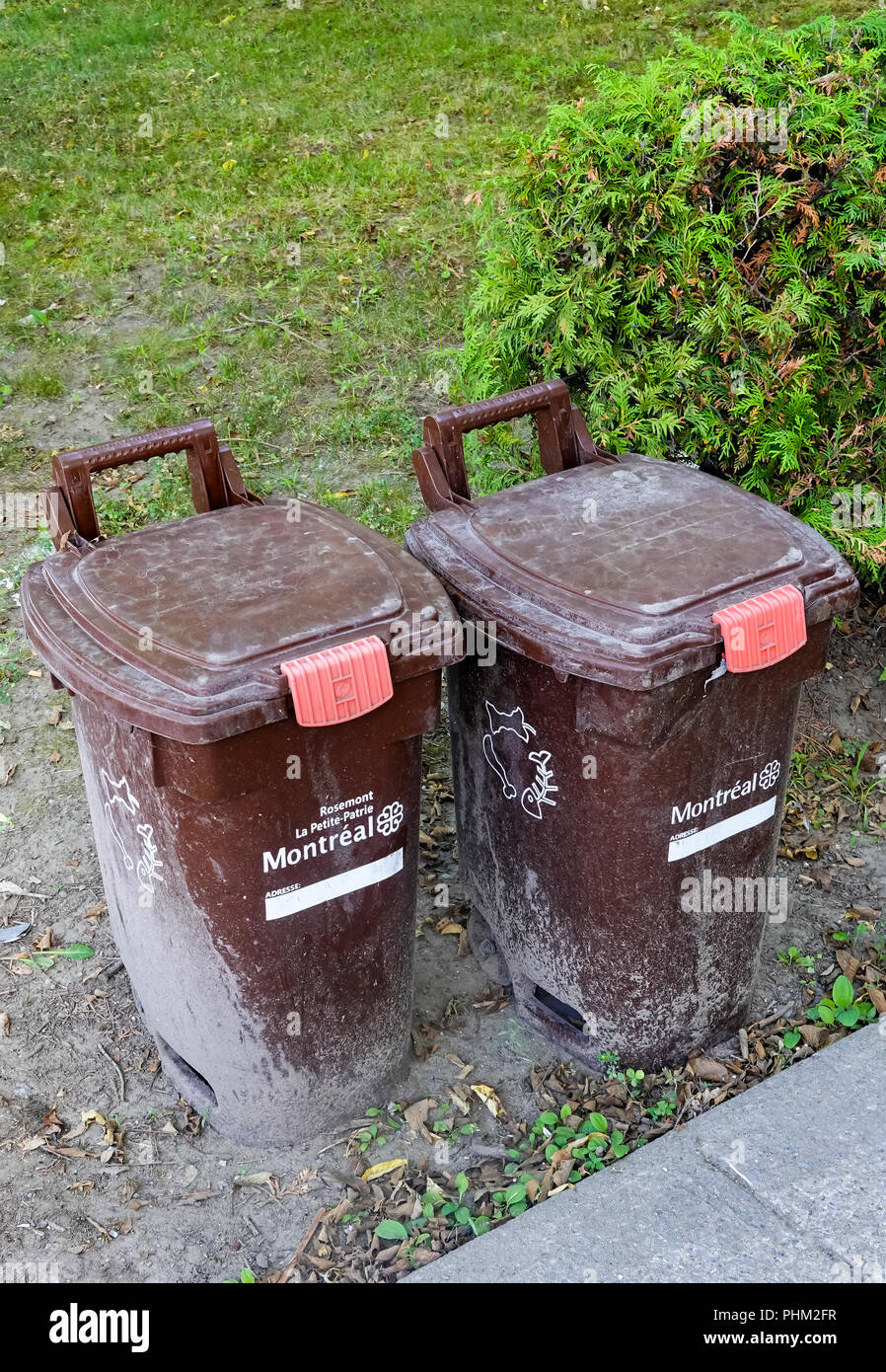 Brown bins for the collection of compost in Montreal, QC, Canada Stock Photo