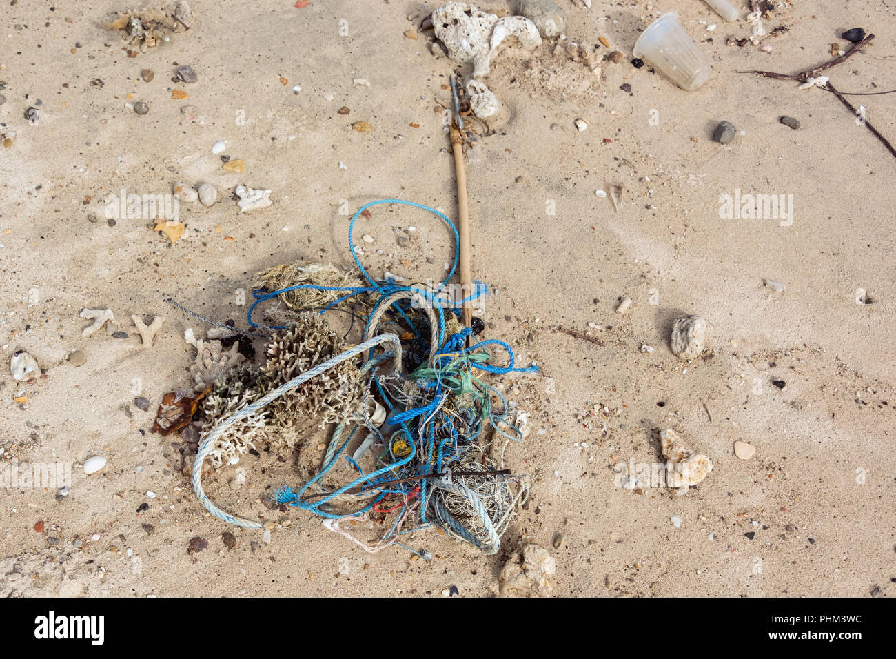 Ocean debris that can ensnare marine animals and birds, washed up on Komodo Island, Indonesia - Stock Image