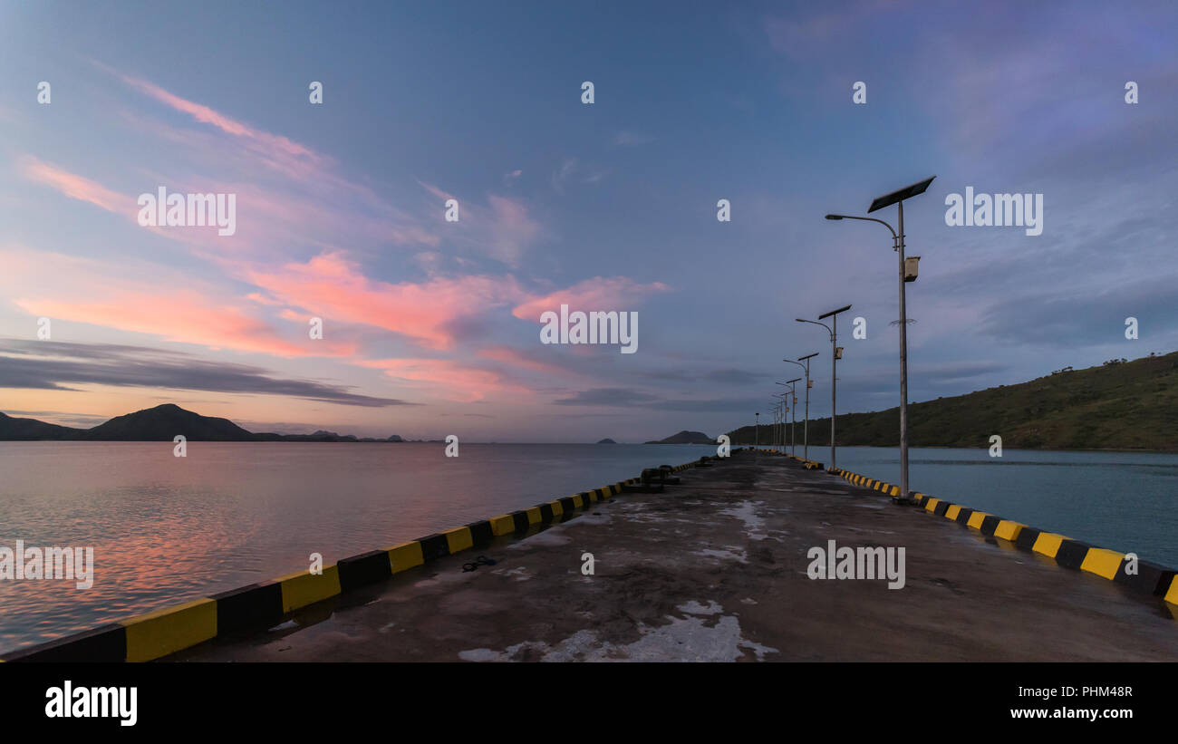 Wharf at Komodo Island at sunrise, Lintah Strait, Indonesia - Stock Image