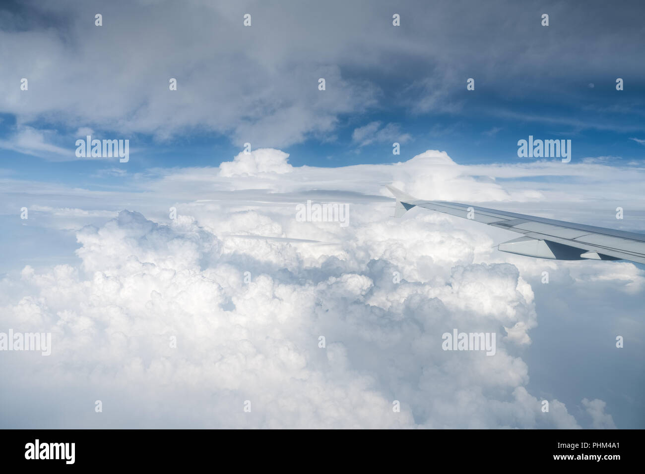 airplane wing above the clouds - Stock Image