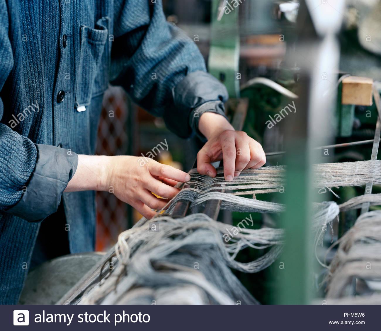 Woman using loom - Stock Image