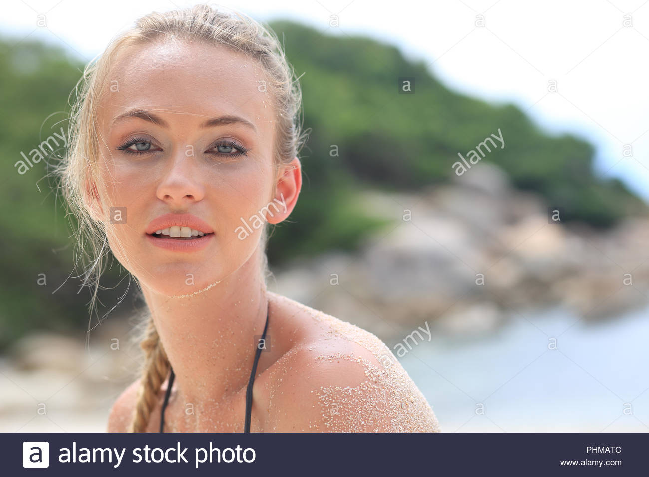Portrait of young woman with sand on her skin Stock Photo