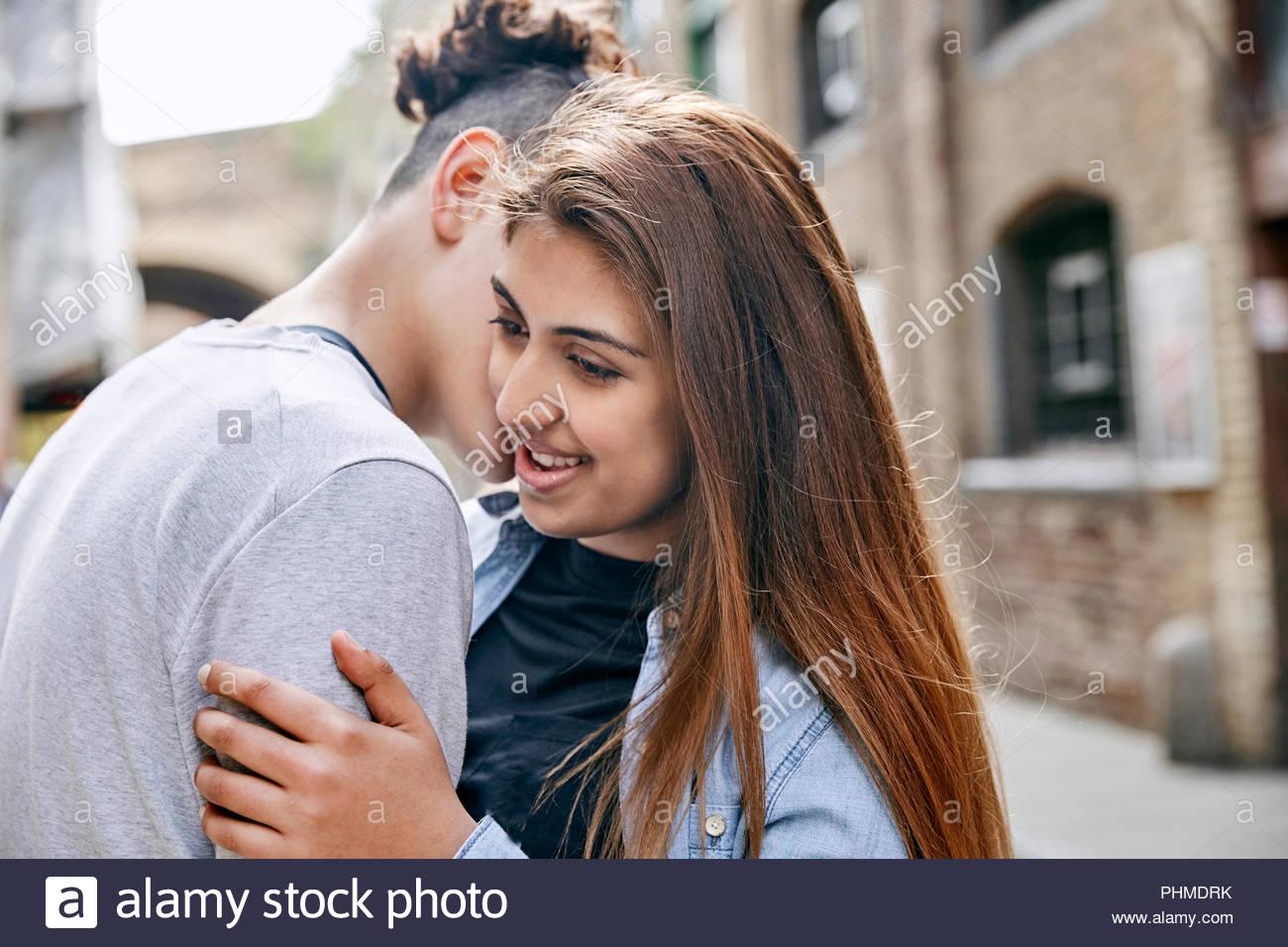 Teenage couple embracing - Stock Image