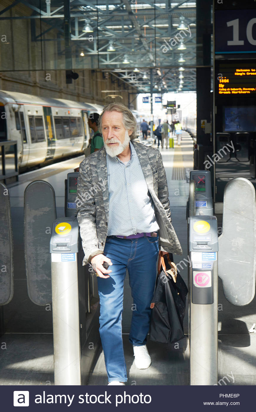 Senior man in train station - Stock Image