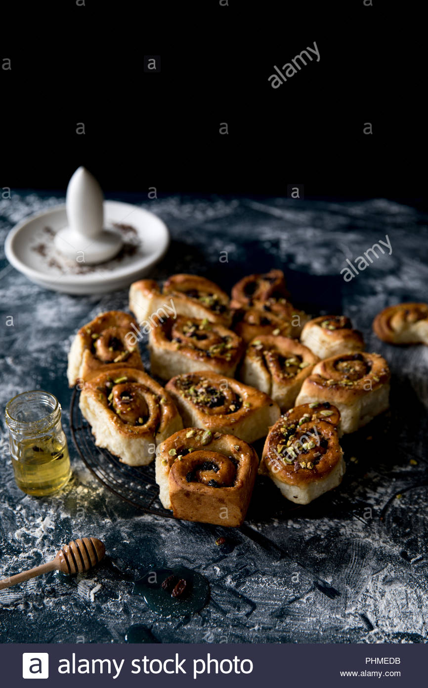 Cardamom and pistachio buns - Stock Image